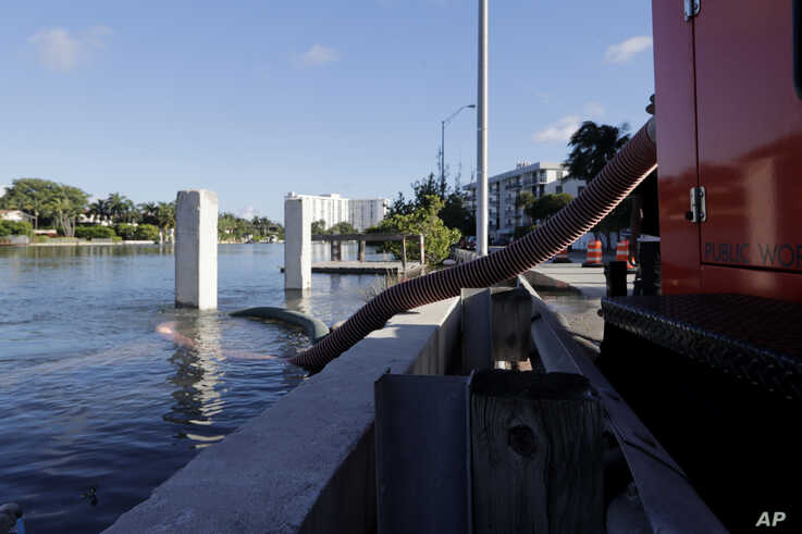 A temporary pumping station is set up along the Intracoastal Waterway to prevent flooding during a king tide, Saturday, Sept