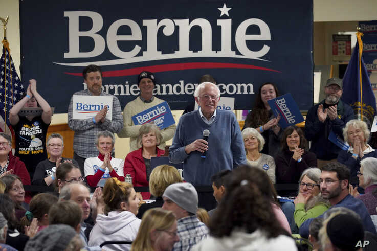 Democratic presidential candidate Sen. Bernie Sanders, I-Vt., smiles as he listens to a question from the audience during a