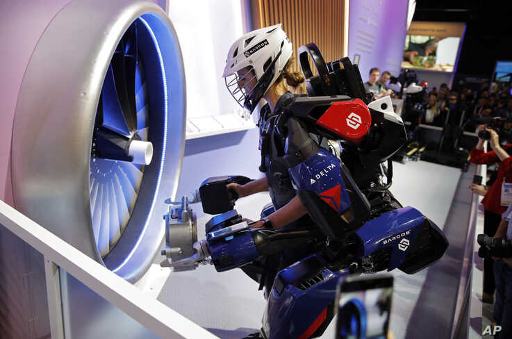 Tara Scranton demonstrates the Sarcos Robotics Guardian XO at the Delta Airlines booth during the CES tech show, Wednesday, Jan…