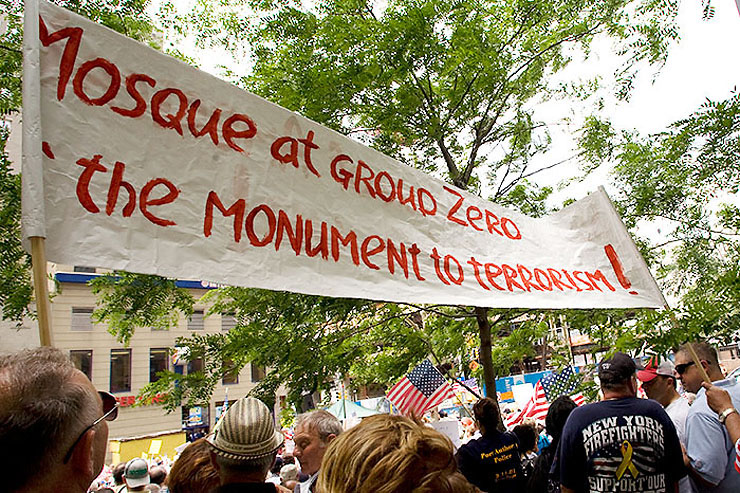 Port Authority Police and FDNY firefighters are seen here gathered beneath this banner. The issues at stake will certainly affect the heart of American freedom, democracy, cultural values and tolerance. Protestors say that America is a tolerant country that allows for the free worship of all its citizens. But our tolerance has limits.