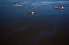 Bunker fuel drifts on the surface of Burrard Inlet after leaking from the bulk carrier cargo ship Marathassa, not seen, in Vancouver, B.C., on Thursday April 9, 2015. THE CANADIAN PRESS/Darryl Dyck