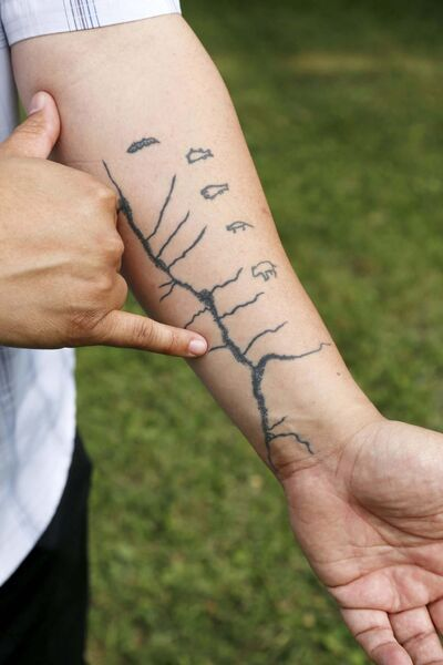 Niigaan Sinclair pays tribute to the Selkirk Treaty with a tattoo on his arm featuring the treaty's accompanying map. (Justin Samanski-Langille / Winnipeg Free Press)</p>