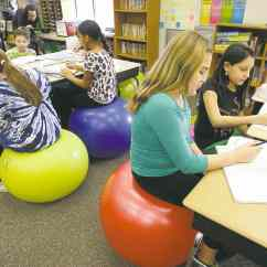 Ball Chairs For Students Dining Chair Danish Design Having A Sitting At Their Desks Winnipeg Free Press In Robbi Giuliano S Fifth Grade Class Sit On Yoga Balls Westtown Thornbury Elementary