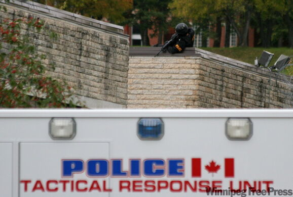 A member of the BPS Tactical Response Unit trains his weapon on a portion of the east side of the Brandon Correctional Institute on Veterans way during a disturbance that lasted over four hours on Sunday afternoon. A group of prisoners took over a portion of the facility and began damaging it. They were eventually contained by members of the Corrections Emergency Response Unit.