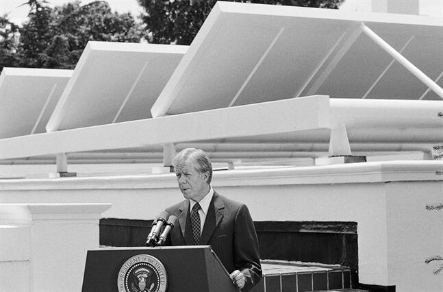 FILE - In this June 21, 1979 black-and-white file photo, President Jimmy Carter speaks against a backdrop of solar panels at the White House. Last October, the Obama administration announced plans to install solar panels on the roof on the roof of the White House by the spring of this year, returning the power of the sun to the pinnacle of prominence a quarter-century after Jimmy Carter's pioneering system was taken down. But spring has come and gone, and the promised panels have yet to see the light of day. (AP Photo/Harvey Georges, File)