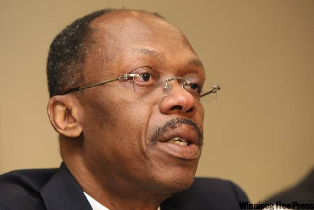 FILE -- A Jan. 15, 2010 file photo shows former Haitian President Jean-Bertrand Aristide during a press conference in Johannesburg, South Africa. Aristide sent out a letter saying he is ready to come back from six years of South African exile