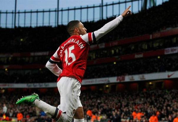 Arsenal's Alex Oxlade-Chamberlain celebrates his goal against Crystal Palace during their English Premier League soccer match at Emirates Stadium in London, Sunday, Feb. 2, 2014. (AP Photo/Sang Tan)