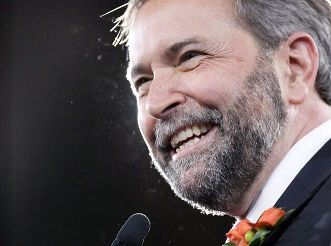 New NDP leader Thomas Mulcair smile on stage during the NDP leadership convention in Toronto on Saturday, March 24, 2012. THE CANADIAN PRESS/Chris Young
