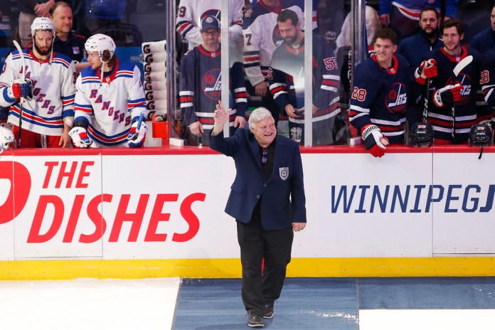 Bobby Hull greets the crowd at a ceremony to honor Thomas Steen and Randy Carlyle by the Winnipeg Jets Hall of Fame before a Jets home game in February.