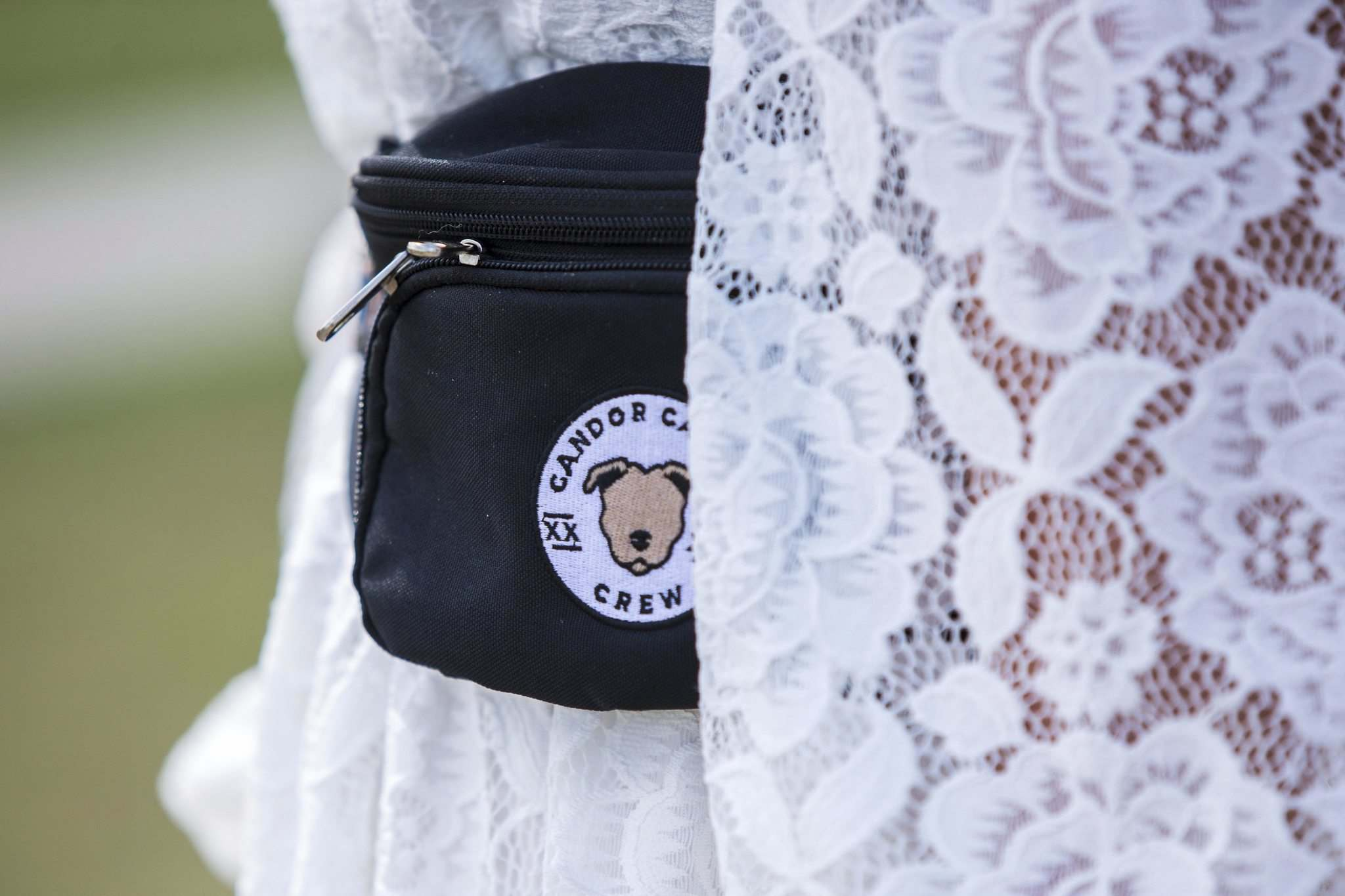 MIKAELA MACKENZIE / WINNIPEG FREE PRESS</p><p>Jamie Barber, owner and head trainer of Candor Canine, carries a branded fanny pack with treats and supplies to keep dogs calm at weddings.</p></p>