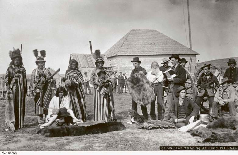 Library and Archives Canada</p><p>Big Bear (centre, seen here in 1884) arrived at Fort Pitt at the close of Treaty Six negotiations; along with chiefs Beardy and Poundmaker, he fought for its implementation as well as for protection of the bison.</p>