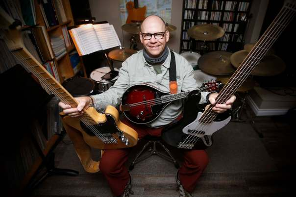 Robert Burton, owner of River Heights School of Music, has treated himself to a couple of new instruments during the pandemic. (John Woods / Winnipeg Free Press)