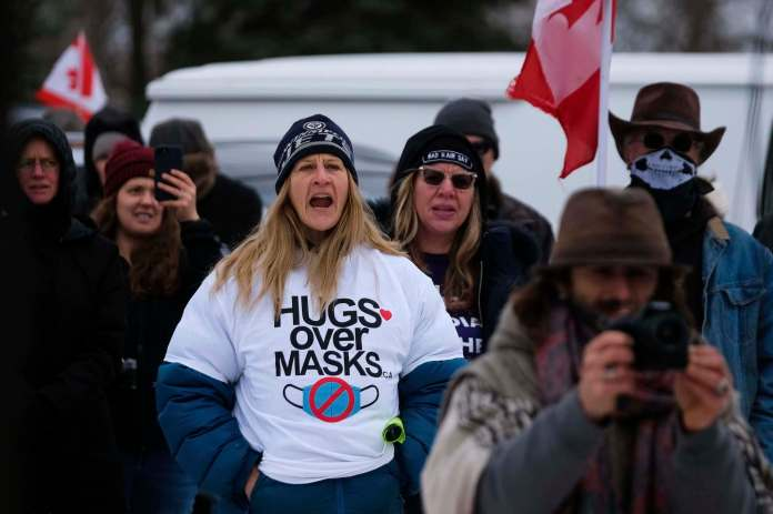 The RCMP blocked the entrance to the city's AD Penner Park after more than 100 people, many of whom described themselves as