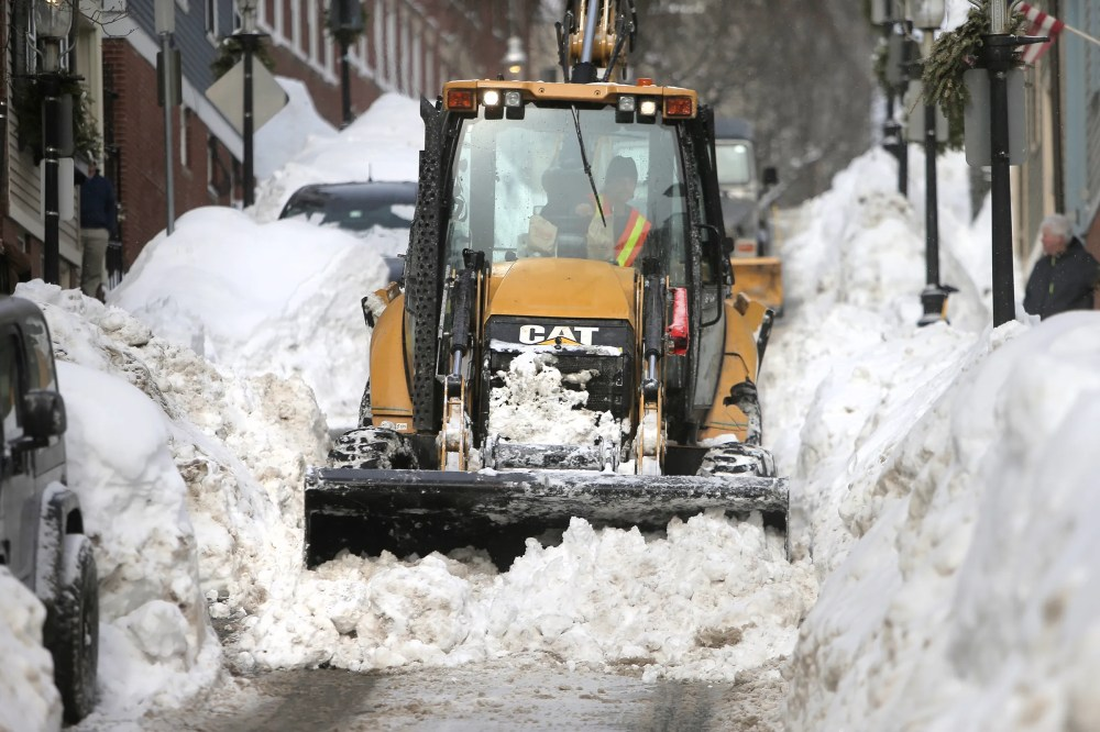 medium resolution of plow driver j j giugliano jr battles the snow on pleasant street near monument square in charlestown