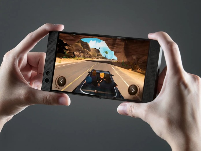 Image may contain Human Person Video Gaming Cell Phone Electronics Mobile Phone and Phone