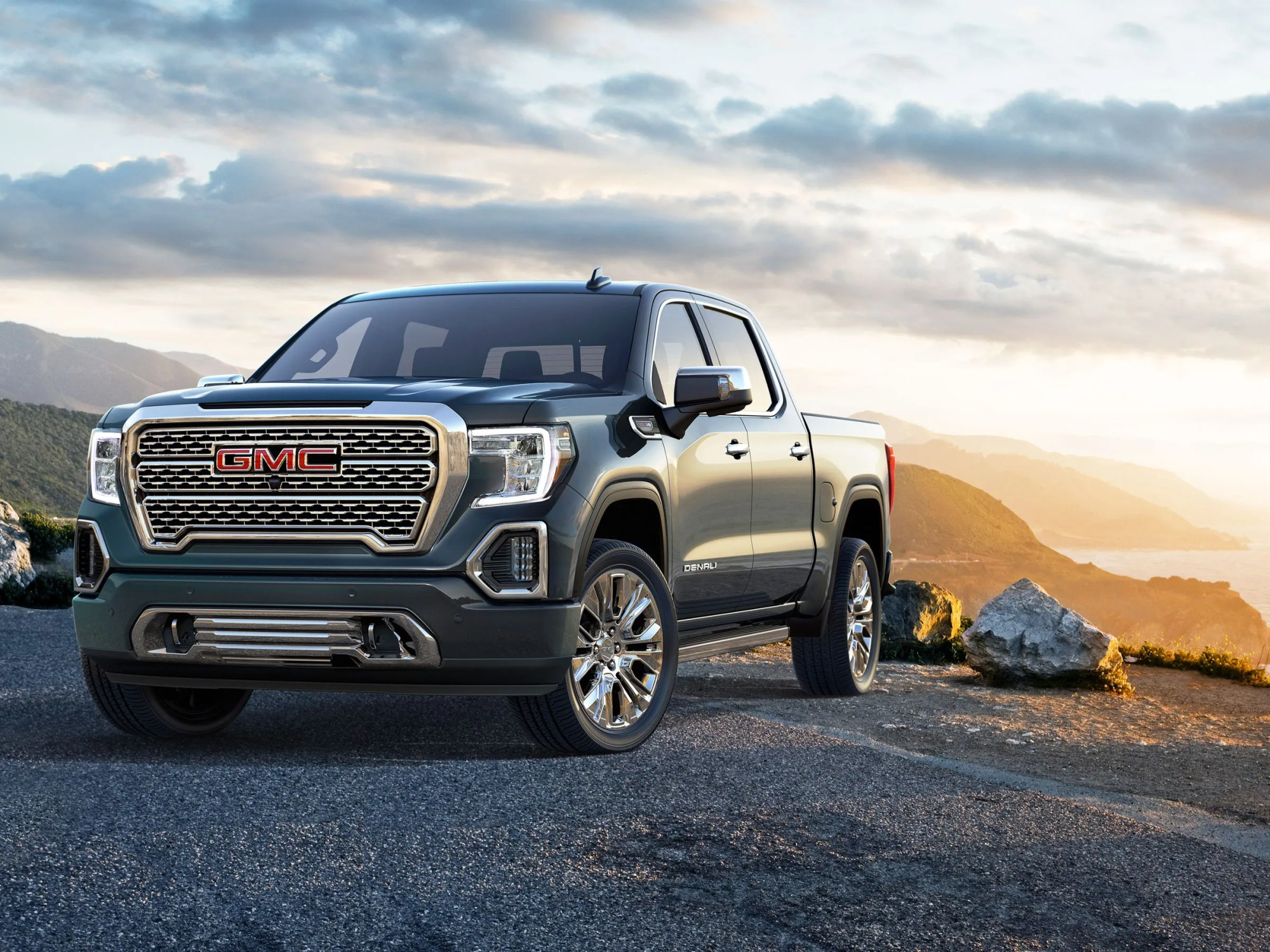 hight resolution of gm one ups ford with a carbon fiber loaded sierra pickup truck
