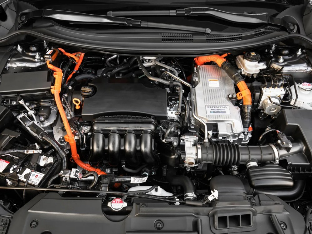 medium resolution of the latest honda hybrid uses two motors an engine and a bevy of buttons paddles and