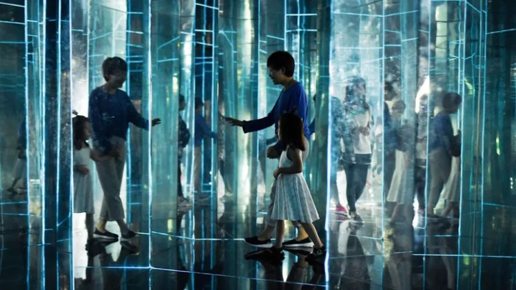 woman and child in glass house