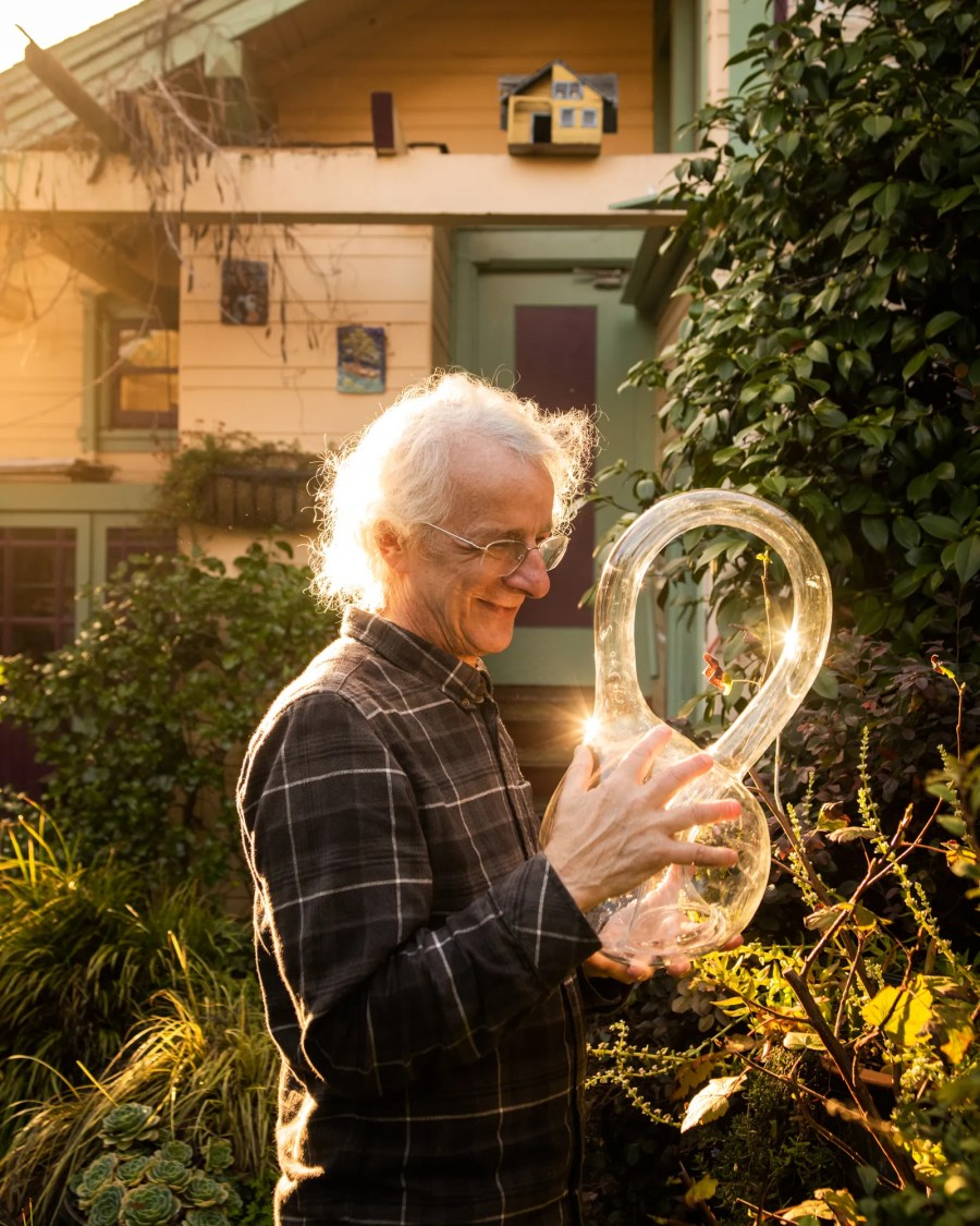 Cliff Stoll holding a klein bottle in his backyard