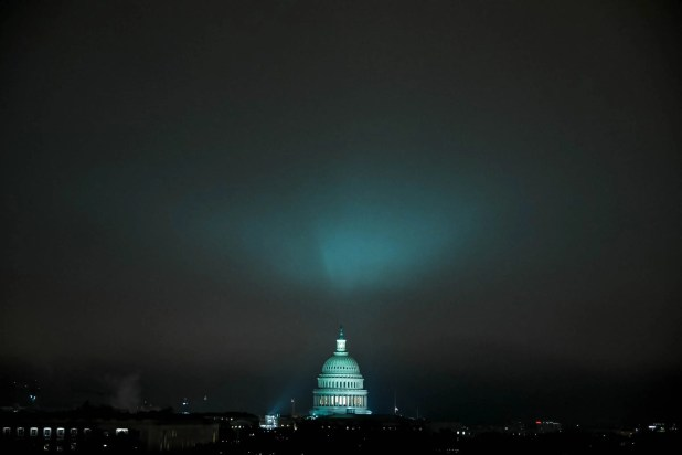 Security: The U.S. Capitol and sky above illuminated in green light