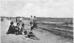 Familj på stranden.