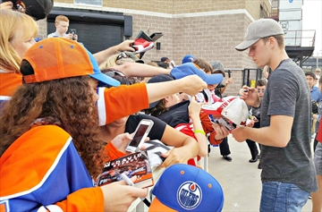 Edmonton Oilers captain Connor McDavid signs autographs for fans about an hour prior to puck drop at Hockey Night in Simcoe County in Barrie Aug. 10.