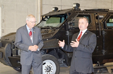 Midland Mayor Gord McKay (left) and Streit Canada director Florin Fleseriu officially announce Streit Manufacturing, an armoured car production plant, has joined the Midland business community.