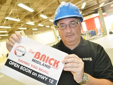 Franchise owner Ron Jacques is opening The Brick in Midland Oct. 27. Money raised during opening day will be donated to Georgian Bay Cancer Support Centre.