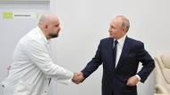 Der inzwischen positiv getestete Arzt Prozenko mit Präsident Putin in der vergangenen Woche.