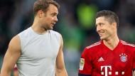 Nach dem Sieg in Wolfsburg ist die Laune bei den Bayern um Neuer (links) und Lewandowski wieder besser.