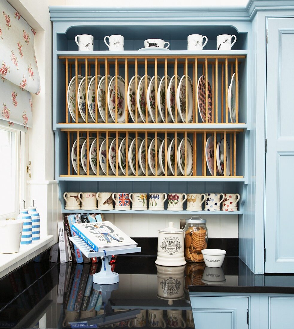 https www living4media com images 11323454 pale blue country house kitchen cabinet with integrated plate rack