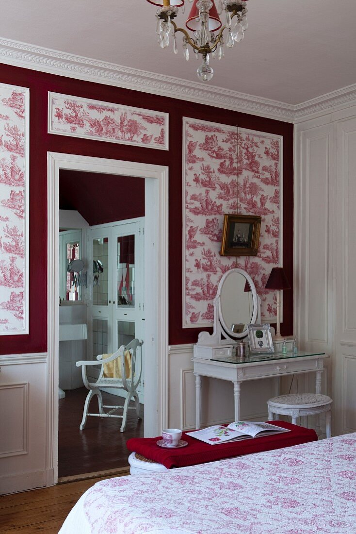 https www living4media com images 11350836 dressing table against red and white toile de jouy wallpaper in bedroom