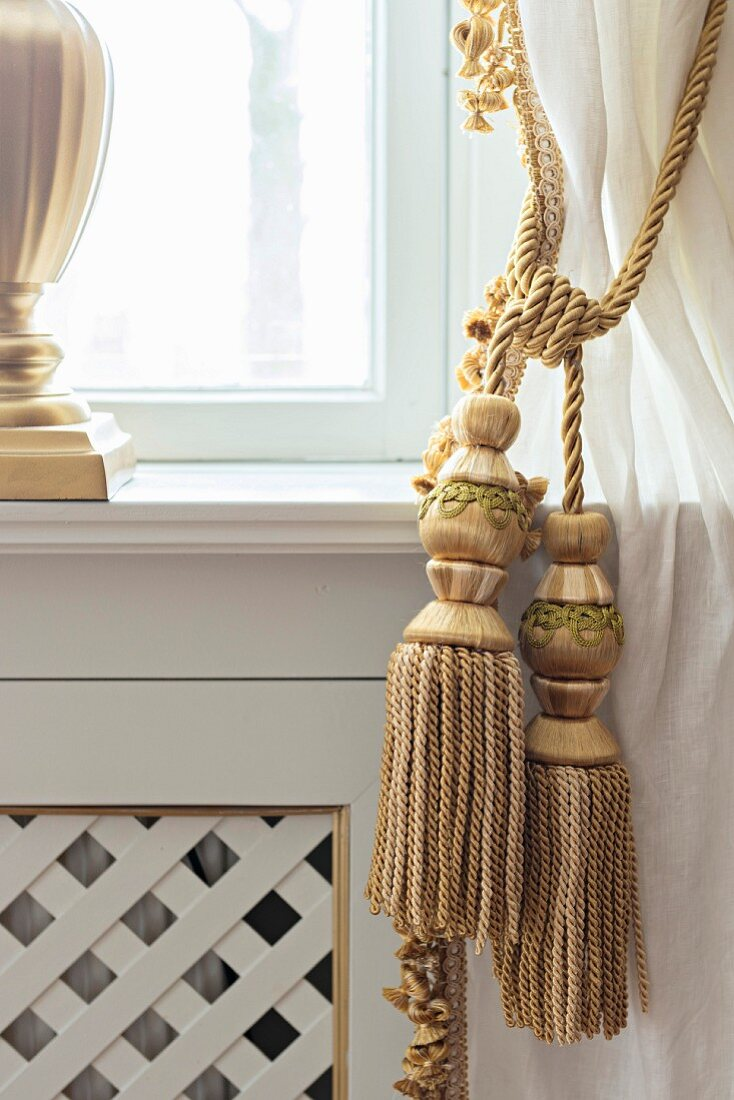 https www living4media com images 11399646 golden cord curtain tie backs with tassels