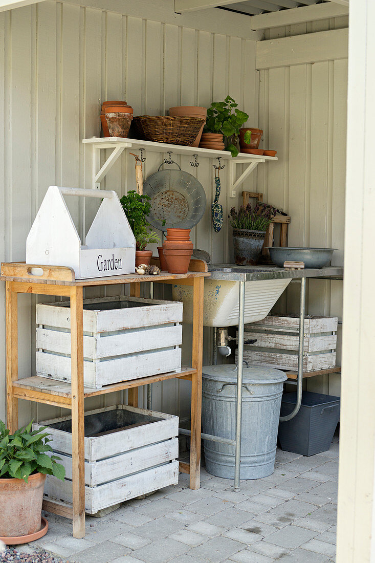 https www living4media com images 12436854 potting table and garden sink in roofed area