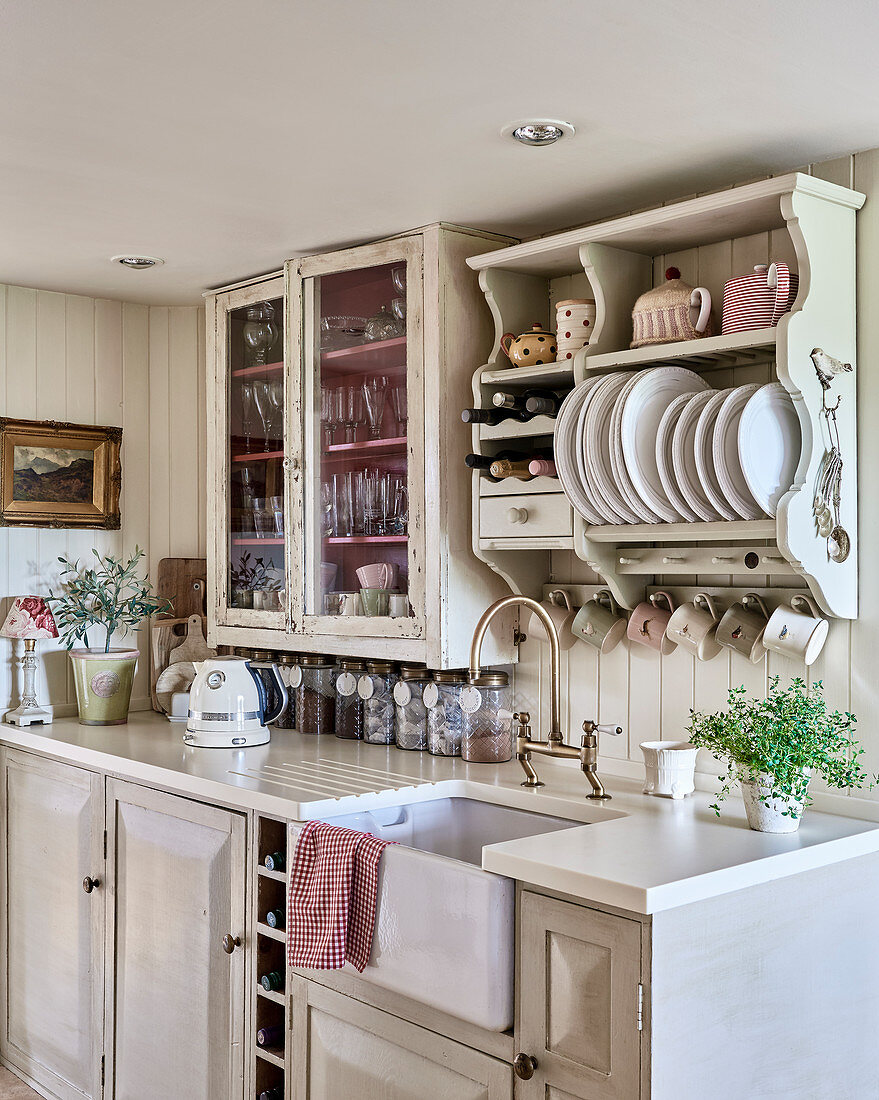 https www living4media com images 12568582 plate rack and glass fronted cabinet above kitchen counter