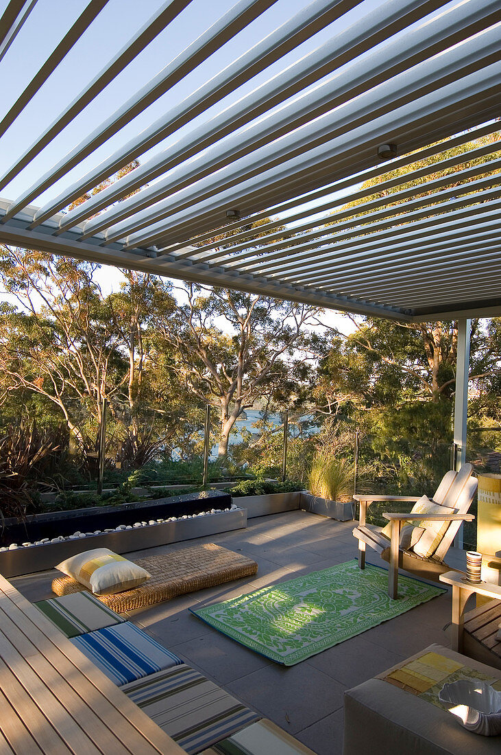 https www living4media com images 12578190 outdoor furniture on terrace with pergola and glass balustrade