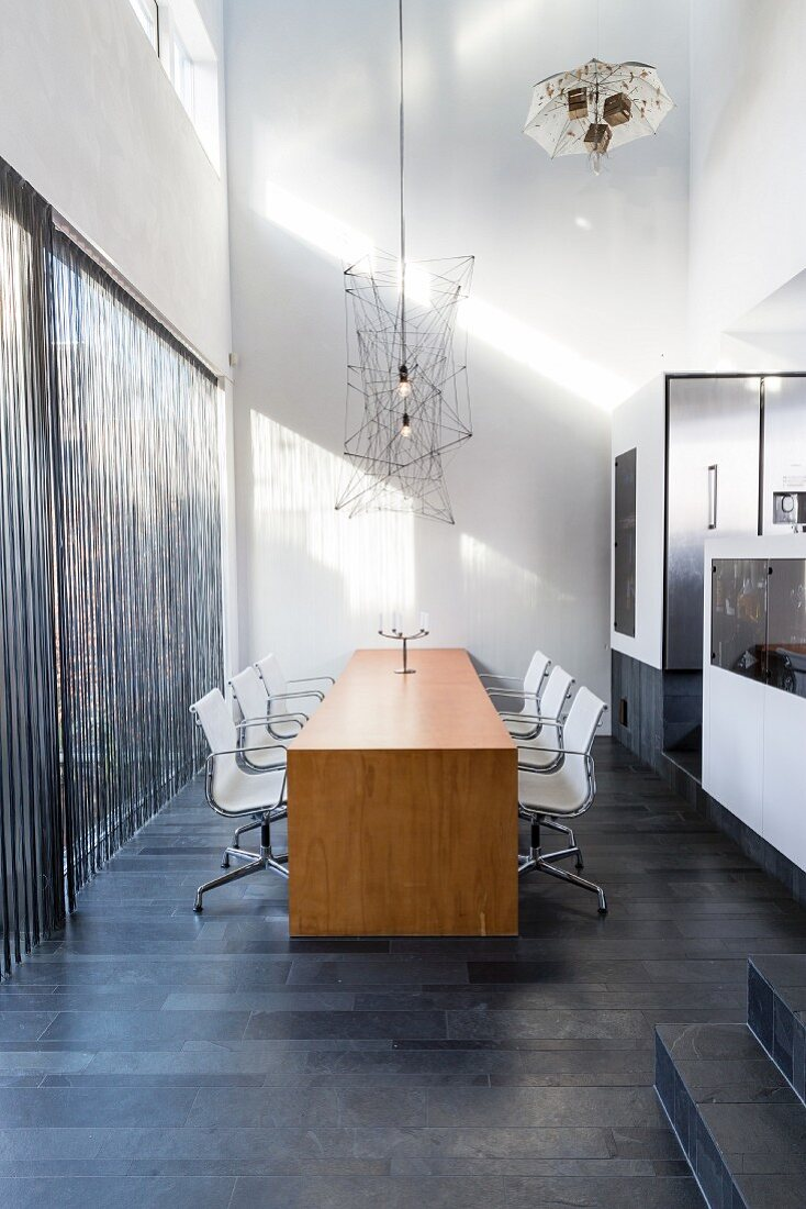 https www living4media com images 12358754 wooden table and white chairs on charcoal grey tiles floor