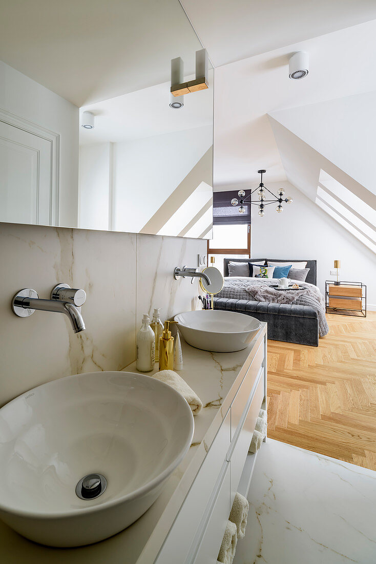 https www living4media com images 12664456 marble washstand with countertop sinks in ensuite bathroom adjoining bedroom