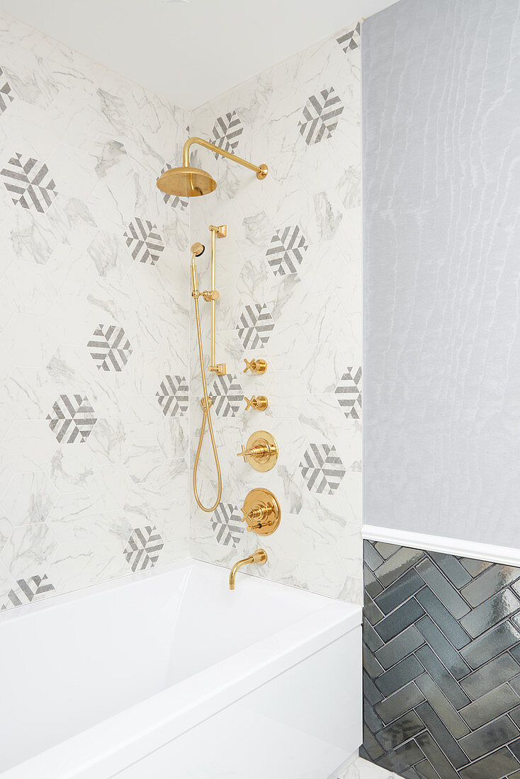 https www living4media com images 12671952 bathroom shower with hexagon marble tiles brass fittings and blue glossy subway tiles in zigzag pattern on