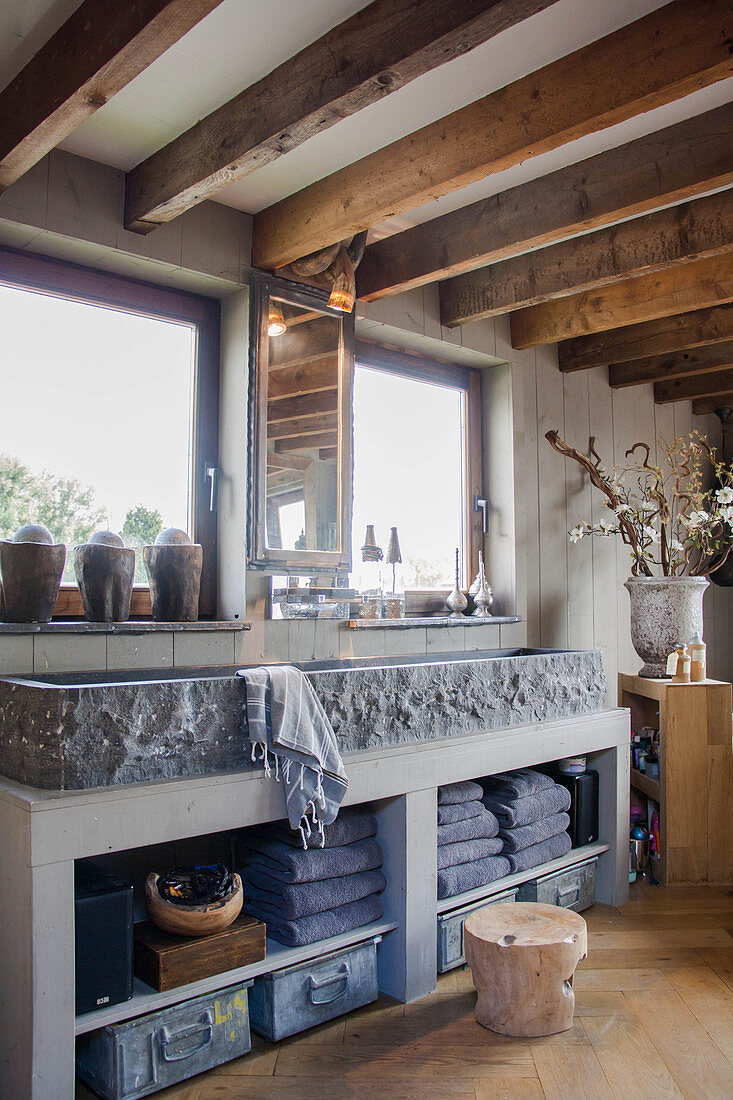 https www living4media co uk images 13265872 stone trough used as sink in rustic bathroom with wood beamed ceiling