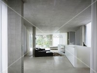 Open living room in concrete with enclosed white banister ...