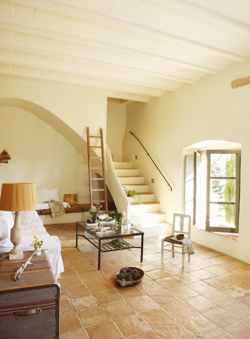 https www living4media com images 11146817 bright interior with terracotta tiles and simple furnishings in spanish mediterranean style