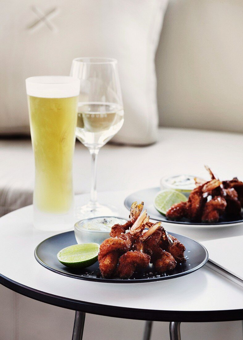 https www living4media com images 11091945 cool drinks and snacks for two arranged on plates on round side table