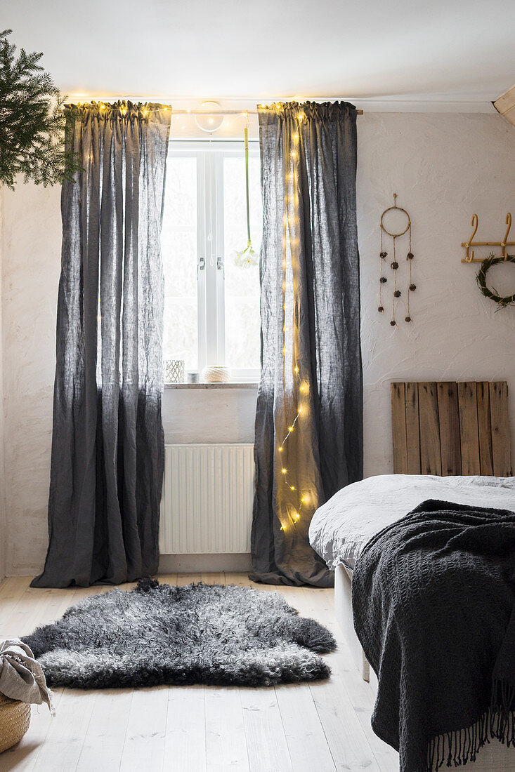 https www living4media com images 12478861 fairy lights on grey curtains in bedroom
