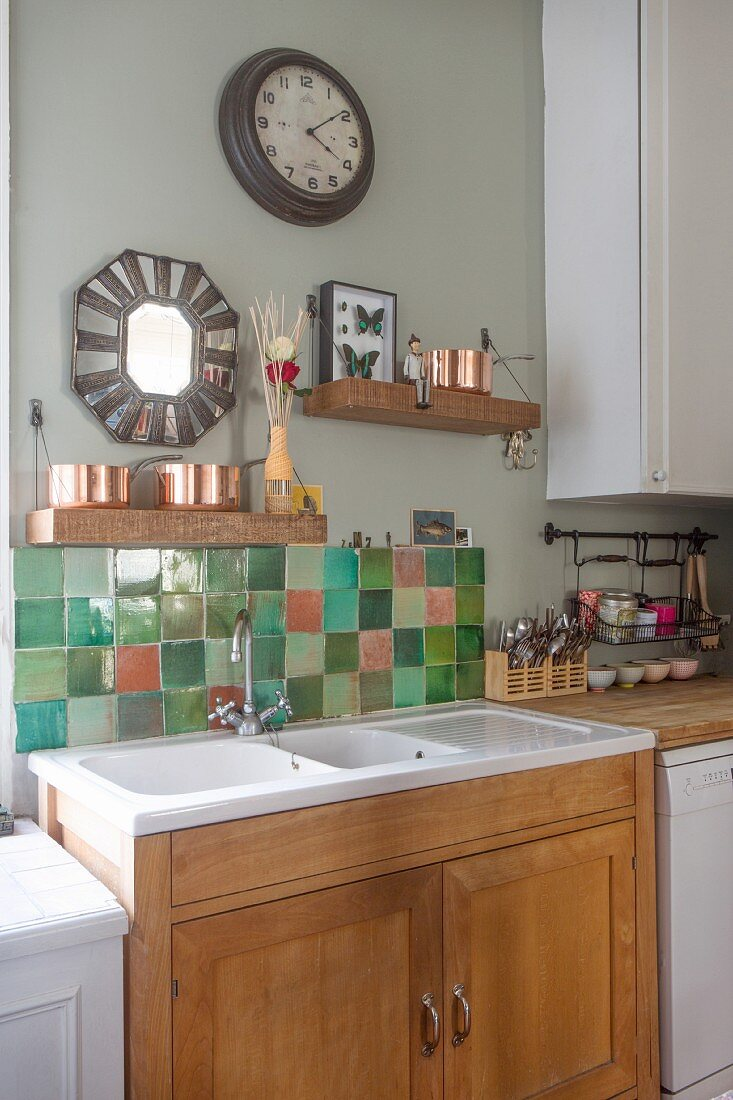 https www living4media com images 12264771 wooden shelves and mirror with tiled surround above kitchen sink