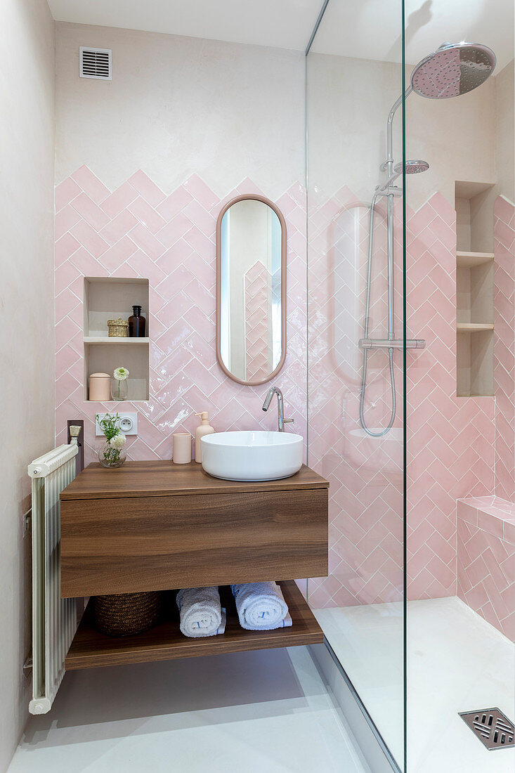 https www living4media com images 13177771 pink herringbone tiles in small bathroom with shower