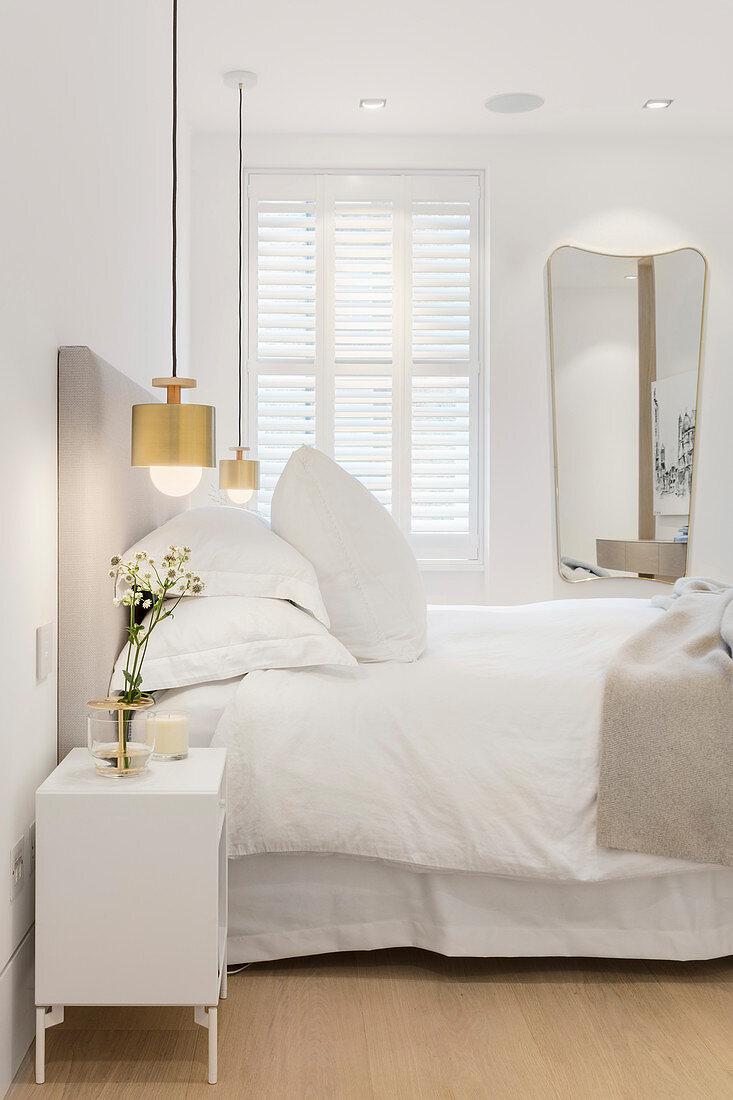 https www living4media co za images 12945447 golden pendant lamps flanking bed in white bedroom