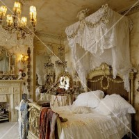 A Rococo-style bedroom  a four poster bed with white ...