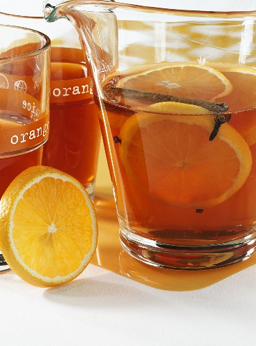 Fruit tea punch with oranges, cinnamon and cloves