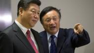 Chinas Staatspräsident Xi Jinping (l.) mit Huawei-Chef Ren Zhengfei